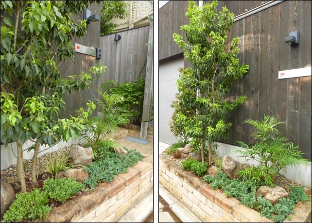 単調な花壇の形を打ち消す自然石